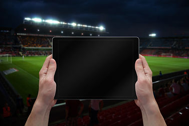 Man holding tablet with blank screen on