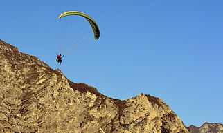 paragliding-jumping-yellow.jpg