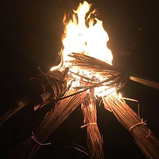Lighting some palm torches from our fat