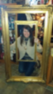 Karen with two large gold frames  122011