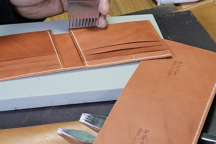 hand-punching-leather-wallet