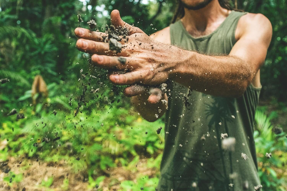 facts-about-soil-crumbling-dirt-between-fingers