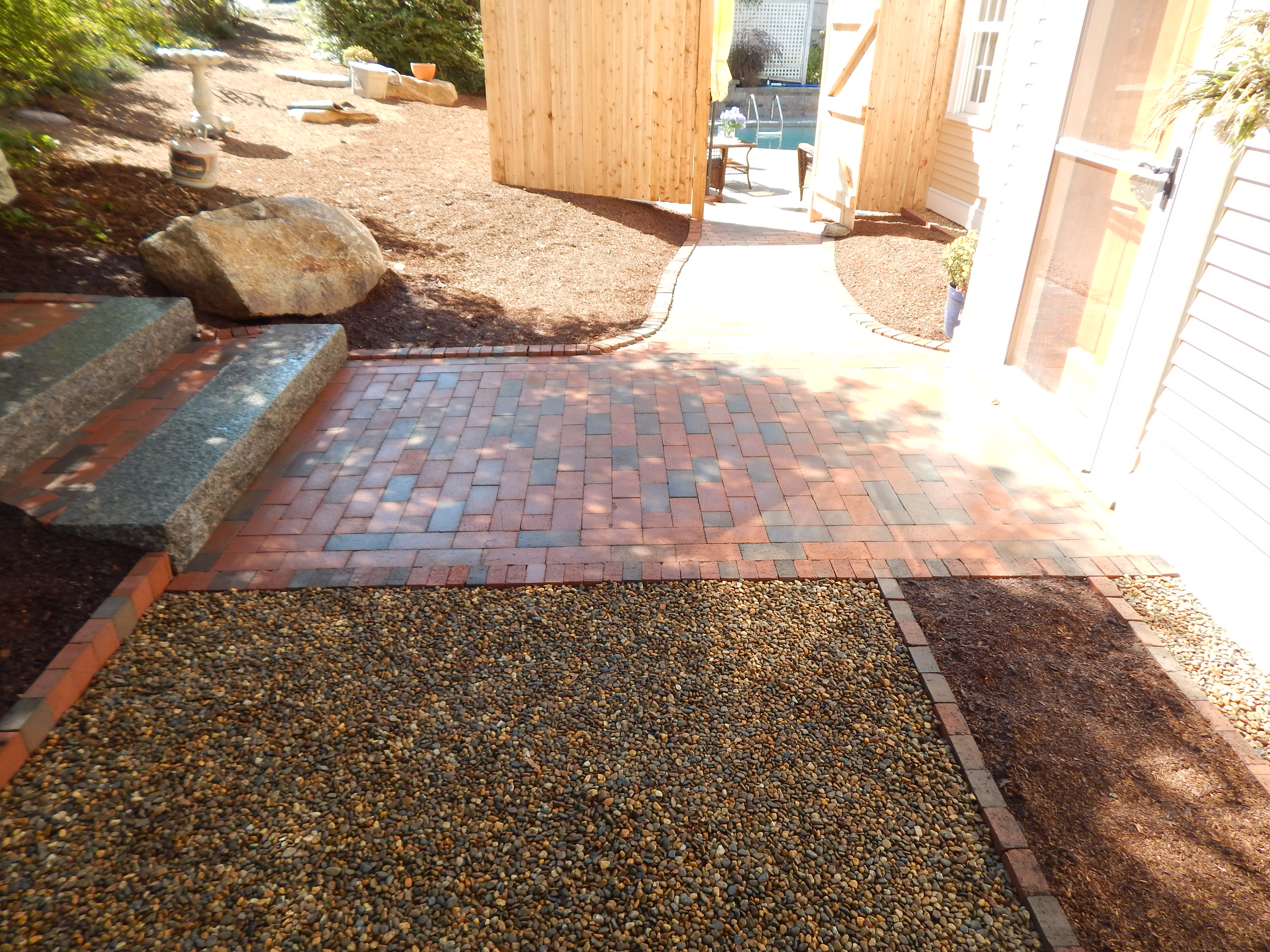 Pea Stone with Brick Edging