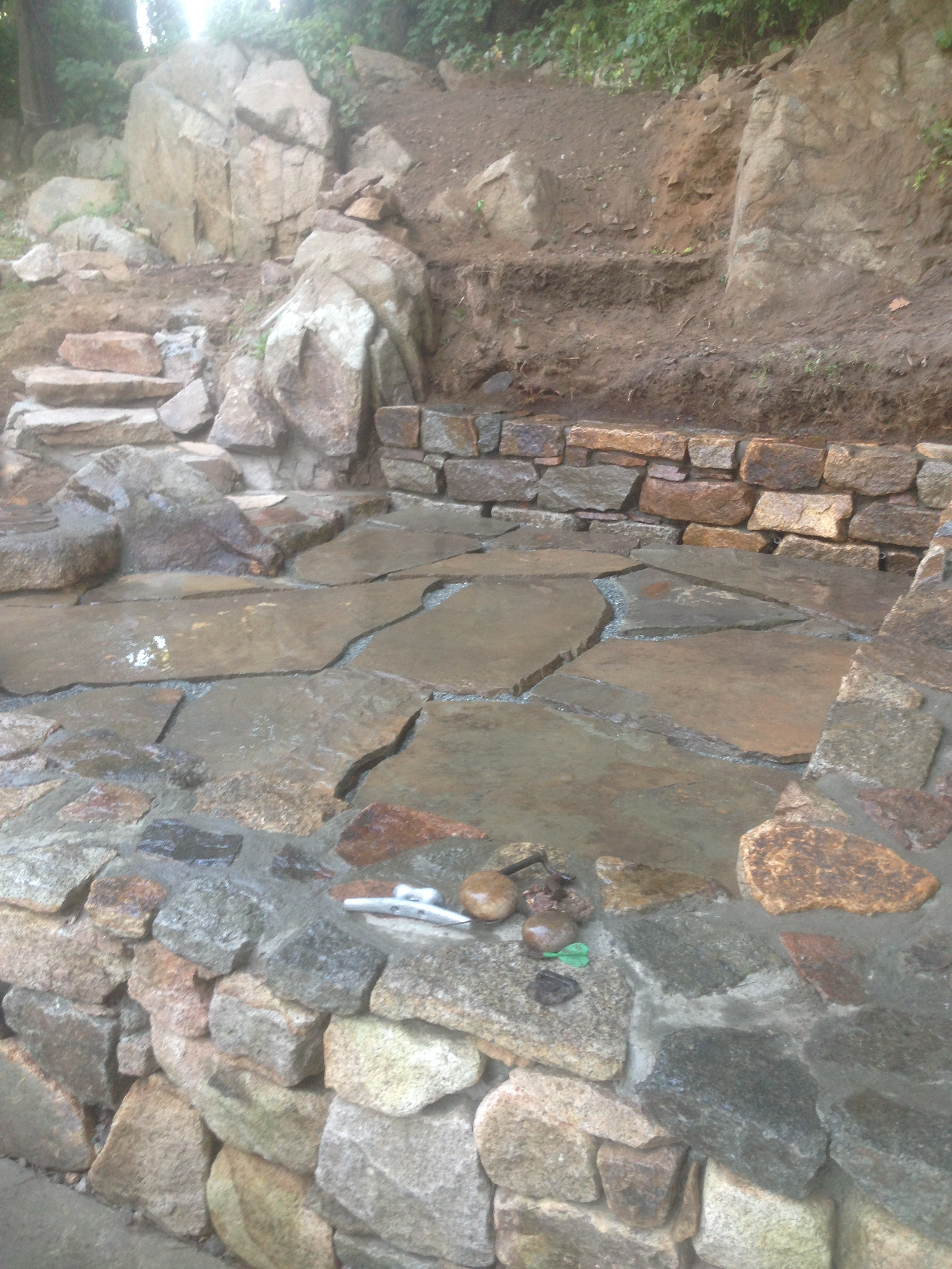 Stone fire pit patio bench seats