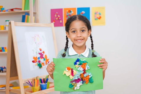Pre-school girl doing art