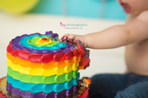 baby photographer, rainbow cake smash, rainbow cake, one year old boy, messy, red cake stand, rainbow balloons, cloud backdrop