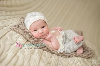 Newborn photographer, baby photography, infant photography, newborn boy,  on back, cream blanket knit backdrop, brown blanket, eyes open, new born posing ideas, white hat, grey pants