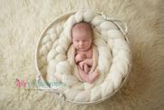 Newborn photographer, baby photography, infant photography, newborn boy, cream wrap, baby wrapping, cream flokati, white backdrop,  hands, fingers, eyes open, white puffy blanket, white basket, cream and white, cream flokati