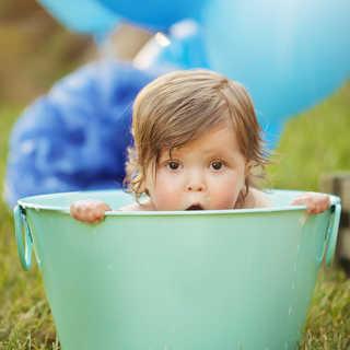 cute baby boy trach outdoor cake smash.j