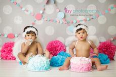 baby photographer, newborn photographer, infant photographer, dc photographer, 1 year old one year old posing ideas, twins, cake smash, cupid wings, blue cake, pink cake, pom poms, wallpaper backdrop