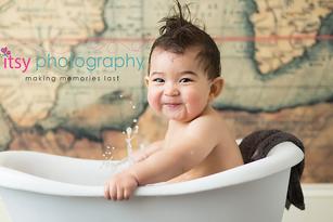 baby photographer, towel, map backdrop, wood floor, white towel, happy baby, first birthday, baby boy, cake smash , dc photographer, family photographer, bath time, baby bathtub, splashing