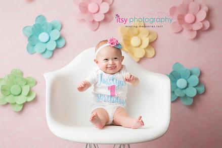 baby photographer, newborn photographer, infant photographer, dc photographer, 1 year old one year old posing ideas, girl, white chair, flowers, pink backdrop