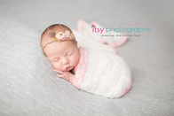Newborn photographer, baby photography, infant photography, newborn girl, grey backdrop, details, headband, head on hands pose, newborn posing ideas, floral headband, baby wrapping, whit and pink lace wrap