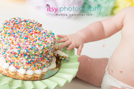 Cake Smash, First Year, first birthday, baby boy, one year old, rainbow, confetti. colorful. pom poms, balloons, rainbow cake, confetti cake, blue backdrop, smiling, happy birthday, baby photographer, one year old posing ideas, dc photographer, photography, spoon, details