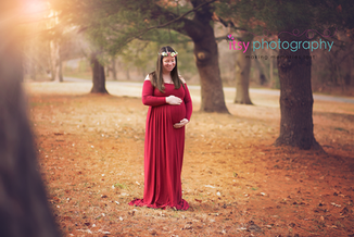 Maternity photography, red dress, gown, flower crown, forest, golden hour, holding belly, maternity posing ideas