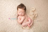 Newborn photographer, baby photographer, newborn, boy, infant, newborn posing ideas, army, cream blanket, cream wrap, mohawk, huck finn pose