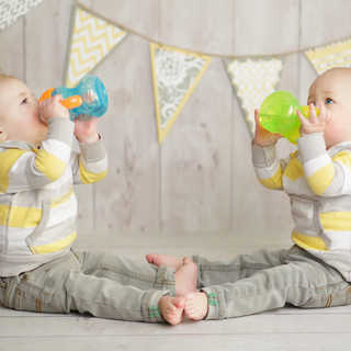 twins drinking sippy cups.jpg