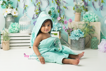 baby photographer, one year old girl, floral backdrop, blue towel, girl, garden