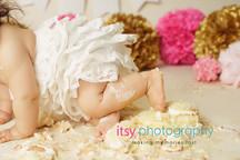 baby photographer, newborn photographer, infant photographer, dc photographer, 1 year old one year old posing ideas, pink and gold, cake smash, white banner, cream backdrop, white dress, pom poms