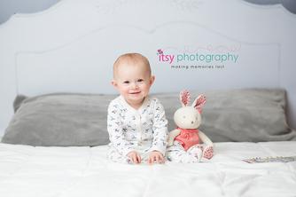 baby photographer, newborn photographer, infant photographer, dc photographer, 1 year old one year old posing ideas, pajamas, bunny, grey pillow, white duvet, bed backdrop