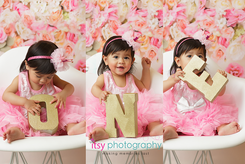 baby photographer, first birthday, one, props, pink dress, white chair, floral backdrop, headband, baby girl