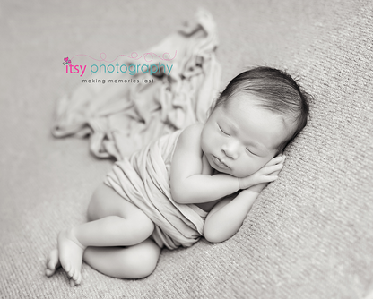 Newborn photographer, baby photography, infant photography, newborn boy, brown backdrop, cream wrap, newborn posing ideas, baby wrapping, head on hands pose.  black and white, studio photography