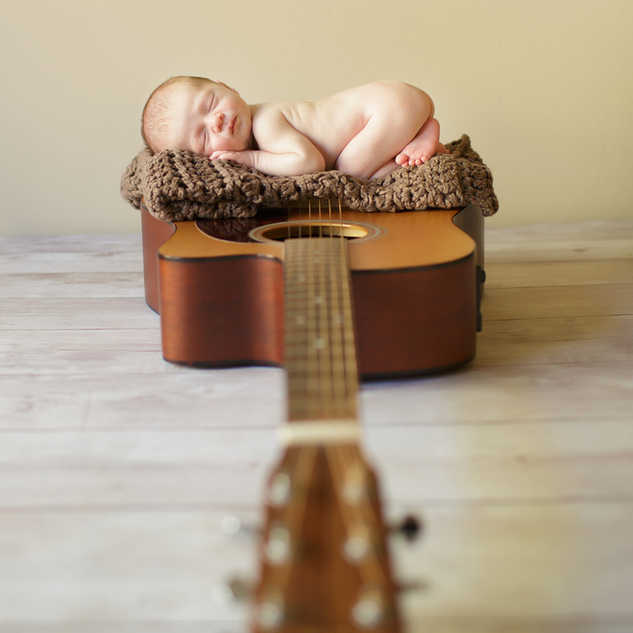 IMG_8682 newborn baby on a guitar.jpg