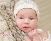 Newborn photographer, baby photography, infant photography, newborn boy,  on back, cream blanket knit backdrop, brown blanket, eyes open, new born posing ideas, white hat,