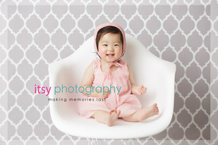 baby photographer, family photographer, one year old girl, grey backdrop wallpaper, white chair, pink outfit , pink bonnet