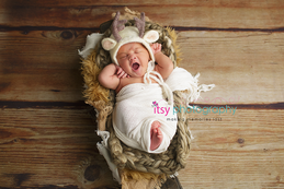 Newborn photographer, baby photography, infant photography, newborn boy, wooden floor backdrop, white wrap, basket, antler hat, yawning, newborn posing ideas, baby wrapping