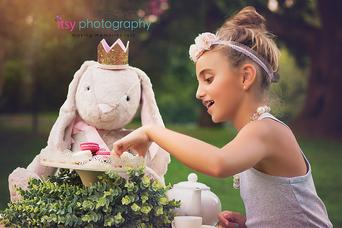 family photographer, tea party, outdoors, maternity , white maternity dress, golden hour, rabbit, alice in wonderland, macrons