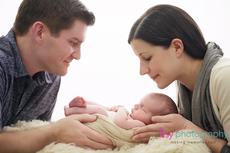 Newborn photographer, baby photography, infant photography, newborn boy, dad, cream wrap, baby wrapping, cream flokati, white backdrop, family,  mom and dad,