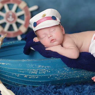 newborn baby boy on a boat.jpg