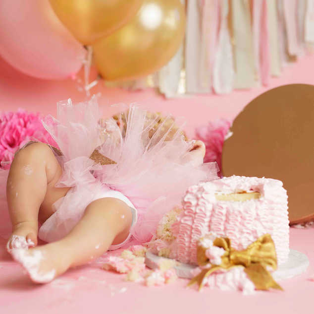 pink gold cake smash passed out.jpg