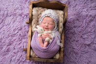 Newborn photographer, baby photography, infant photography, newborn girl, newborn wrapping, purple flokati, purple wrap, bonnet. bunny