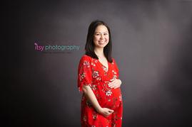 Maternity photography,  floral  maternity dress, studio session,  newborn photographer, maternity posing ideas, mom , black backdrop, red maternity dress,