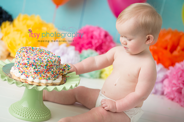 Cake Smash, First Year, first birthday, baby boy, one year old, rainbow, confetti. colorful. pom poms, balloons, rainbow cake, confetti cake, blue backdrop, smiling, happy birthday, baby photographer, one year old posing ideas, dc photographer, photography, spoon
