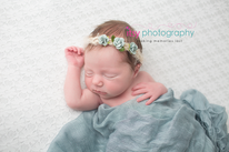 Newborn photographer, baby photography, infant photography, newborn girl, white floor backdrop, white basket, lace outfit, headband, white blankets, blue wrap, blue flowers, newborn posing ideas,