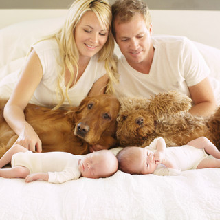 family of twins on a bed.jpg