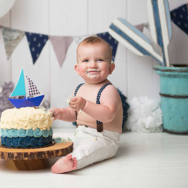 IMG_1208 navy blue sail boat cake added.