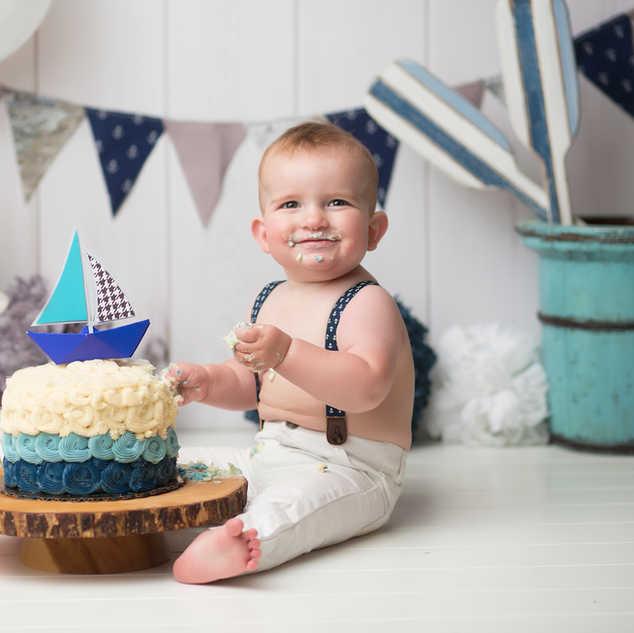 IMG_1208 navy blue sail boat cake added.