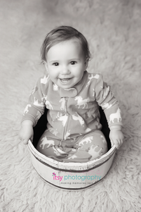 Cake smash, one year old girl, baby girl, baby photographer, newborn photographer, infant photographer,  pink flokati, unicorn footie pajamas, black and white