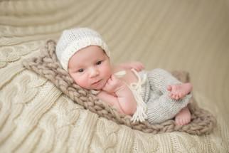 Newborn photographer, baby photography, infant photography, newborn boy, cream backdrop, newborn posing ideas,