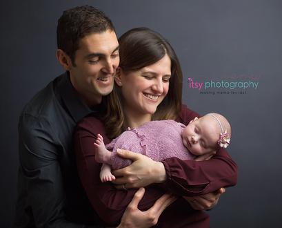 Newborn photographer, baby photography, infant photography, newborn girl, mom and dad, family, baby wrapping, newborn posing ideas, headband, maroon shirt, grey backdrop