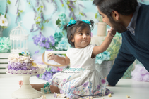 baby photographer, one year old, girl, cake smash, garden, blue, purple, green. blue floral hair clips, white dress, dad