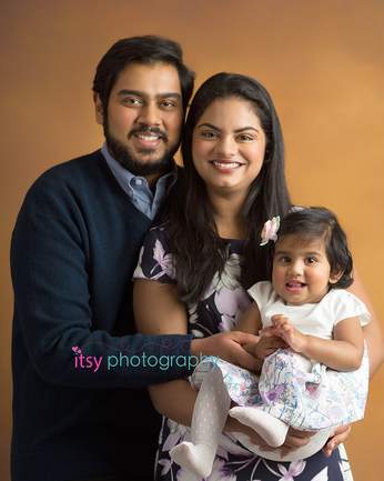 baby photographer, one year old, girl, family, mom, dad, orange backdrop, family