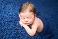 Newborn photographer, baby photographer, newborn, boy, infant, newborn posing ideas,head on hands pose, blue blanket, blue wrap,