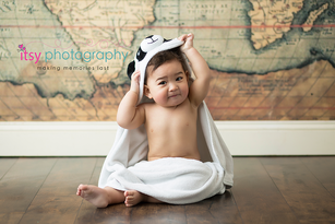 baby photographer, towel, map backdrop, wood floor, white towel, happy baby, first birthday, baby boy, cake smash , dc photographer, family photographer, panda towel