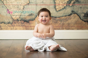 baby photographer, towel, map backdrop, wood floor, white towel, happy baby, first birthday, baby boy, cake smash , dc photographer, family photographer