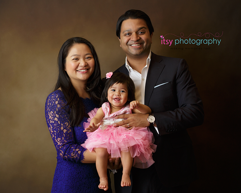 baby photographer, family photographer, pink dress, blue dress, mom , dad, baby girl, brown backdrop
